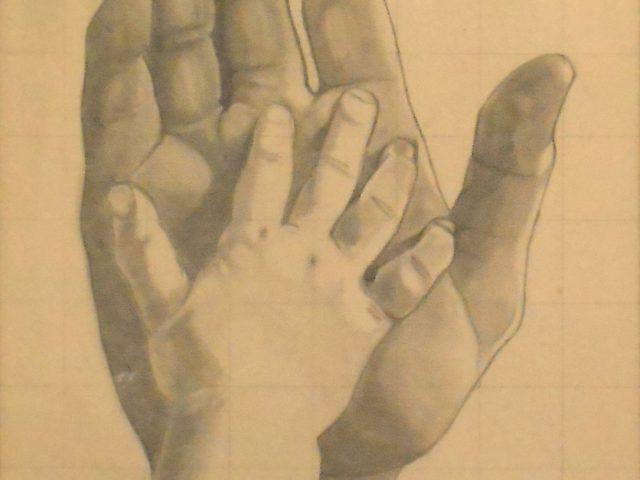 La main de Renaud dans celle de son père