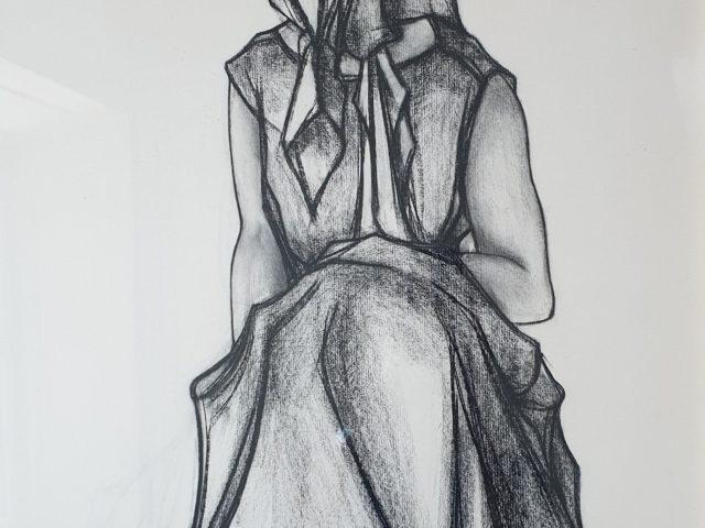 Femme accroupie